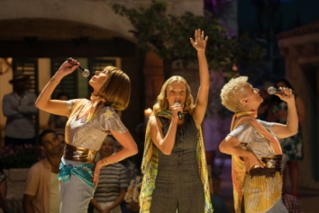 """(L to R) Tanya (CHRISTINE BARANSKI), Sophie (AMANDA SEYFRIED) and Rosie (JULIE WALTERS) in """"Mamma Mia! Here We Go Again."""" Ten years after """"Mamma Mia! The Movie,"""" you are invited to return to the magical Greek island of Kalokairi in an all-new original musical based on the songs of ABBA."""