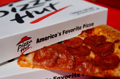 A pepperoni pizza from a Pizza Hut restaurant, a unit of Yum! Brands Inc., is arranged for a photograph in Torrance, California, U.S., on Monday, Oct. 7, 2013. Yum! Brands Inc. is scheduled to release earnings data on Oct. 8. Photographer: Patrick T. Fallon/Bloomberg via Getty Images