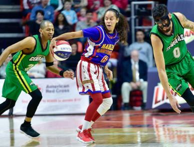 """Stephen Haas/The News-Gazette Brian """"Hoops"""" Green, of the Harlem Globetrotters, keeps the ball away from a pair of Washington Generals players during the Harlem Globetrotters event at the State Farm Center Friday, Jan. 19, 2018, on the University of Illinois campus in Champaign."""